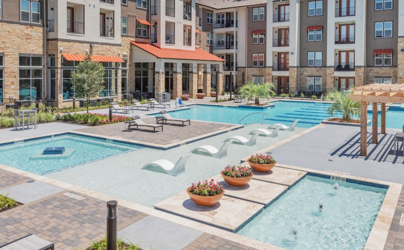 Pool at Radius West surrounded by the buildings with apartments