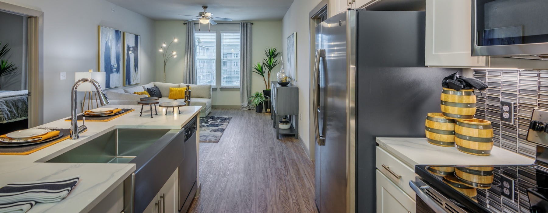 Model unit at Radius West showing the kitchen and living room all comfortably furnished